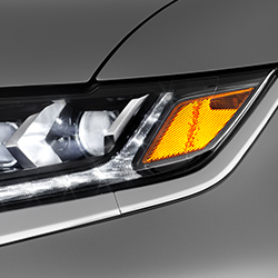 Close up of the LED headlights on the front of a 2019 Mitsubishi Outlander PHEV SUV.