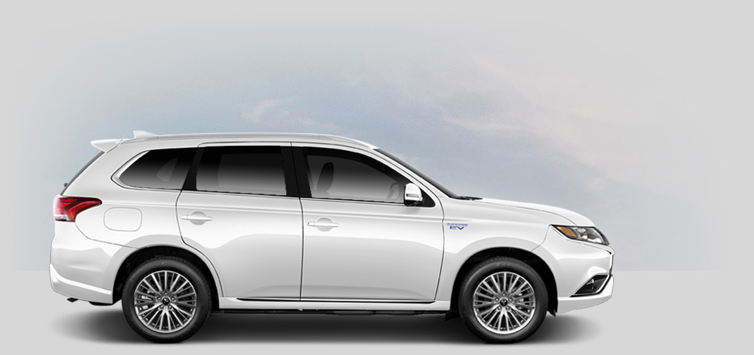 A side view of a pearl white Mitsubishi Outlander Phev.